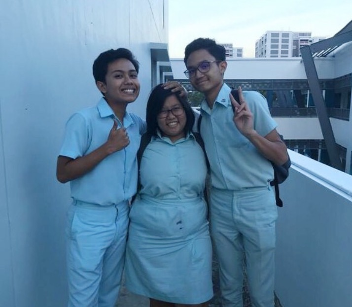 Muhammad Mikhail Bin Azmi with two of his close friends